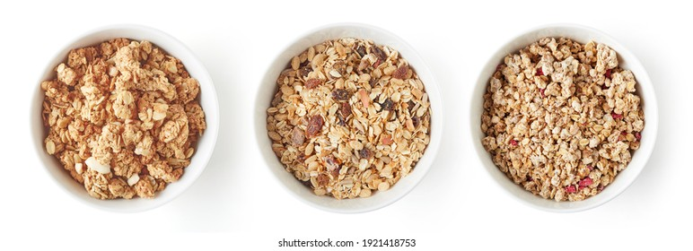 Set of whole grain muesli in white bowl isolated on white background, top view