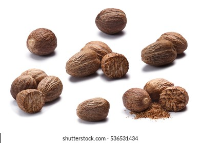 Set of whole and ground nutmegs (seeds of Myristica fragrans). Clipping paths for each object, shadows separated