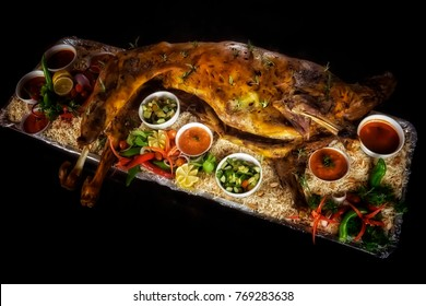 A set of Whole Lamb Mandy Rice served on large tray complete with side dishes. Soft and selective focus applied.