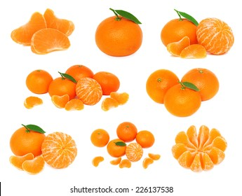 Set whole and sliced mandarines with green leaves isolated on white background