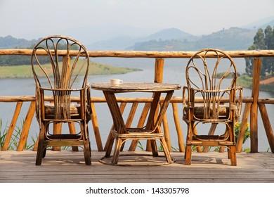set of wicker deck chairs beside a wicker table