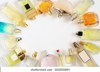 Set of woman perfumes lying on white background. Top view point.