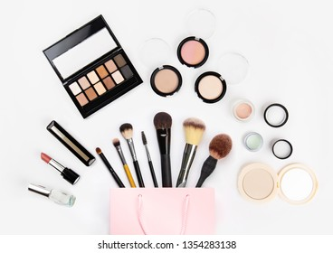Set of woman's cosmetics in a bag. Women's secrets. Cosmetics, perfume, brushes, powder, highlighter, concealer,patelle with eye shadows. female cosmetics bag on white background. Make up. Copy space