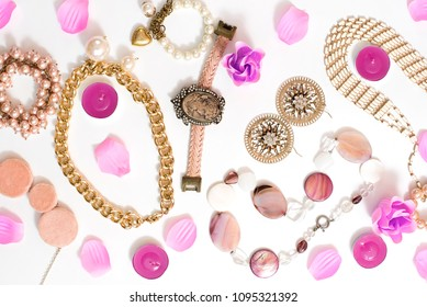 Set of women's jewelry in vintage style necklace cameo pearl bracelet chain earrings on white background. The view from the top lay flat.