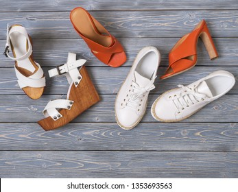 Set of womens shoes (flat sandals) on  wooden background. Spring summer collection. Flat lay. Fashion concept. Template for online store, coupon, offer, promotion, discounts, gift card, deals