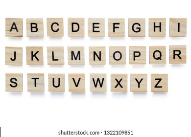 Set of wooden English alphabet blocks with letters - isolated on white background with clipping path.