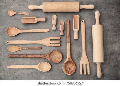 Set of wooden kitchen utensils on table