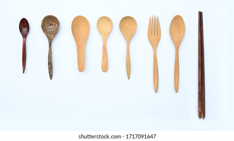 Set wooden spoon, fork and chopstick isolated over white background. Top view