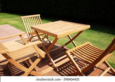 Set Of Wooden Table And Chairs In The Garden