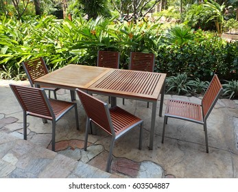Set of wooden table and chairs at a hotel terrace