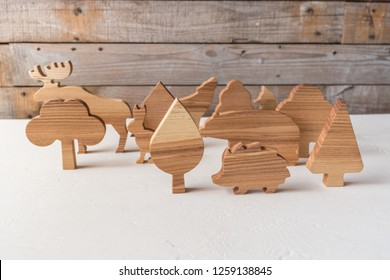Set of wooden trees handmade. Waldorf toys on wooden background