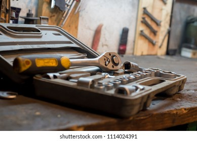 A set of working tools in the old garage and work desk