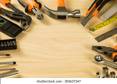 Set of working tools on wooden table