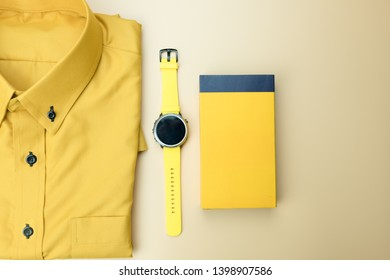 Set of yellow accessories outfits for men on yellow background. Trendy fashion male flat lay background