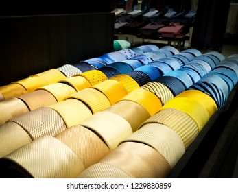 Set of yellow and blue tone of necktie.  Many pattern of them.  Men decoration.