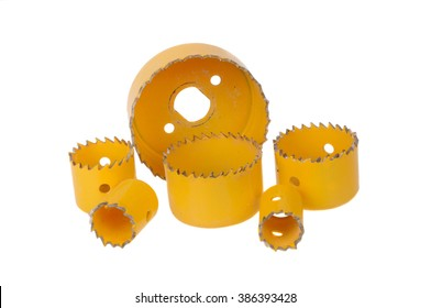 A set of yellow hole saw drill bits isolated on a white background