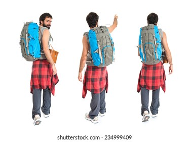 Set of Young backpacker walking over white background