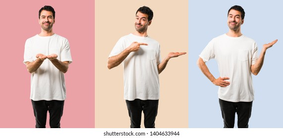 Set of Young man with white shirt holding copyspace imaginary on the palm to insert an ad on colorful background