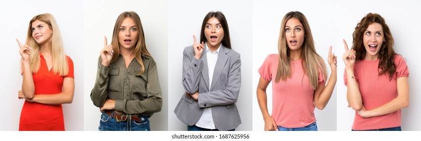 Set of young women over white background thinking an idea pointing the finger up