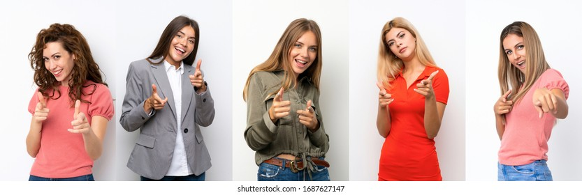Set of young women over white background pointing to the front and smiling