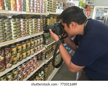 Setapak, Kuala Lumpur, Malaysia, 7th December 2017- A photographer is taking a picture of a cat food product at pet store