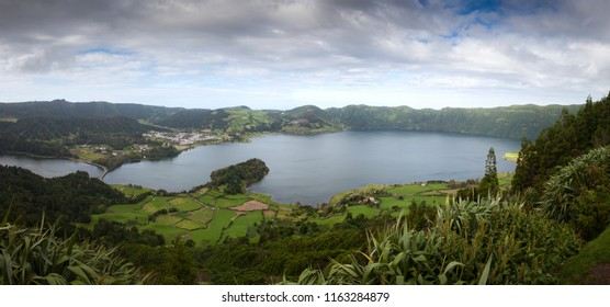 Sete Cidades Massif with lake and village aerial view under heavy clouds