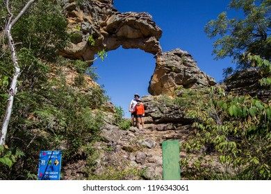 SETE CIDADES, PIAUI, BRAZIL- JULY 20 2018: a couple of tourists below of a stone formation resembling the Brazil map in Sete Cidades, Piaui state, Brazil