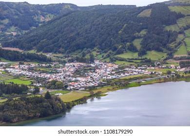 """Sete Cidades town on the bank of the Lake of Sete Cidades (""""Seven Cities Lake""""), Sao Miguel island, Azores (Açores), Portugal. View from Miradouro do Cerrado das Freiras"""