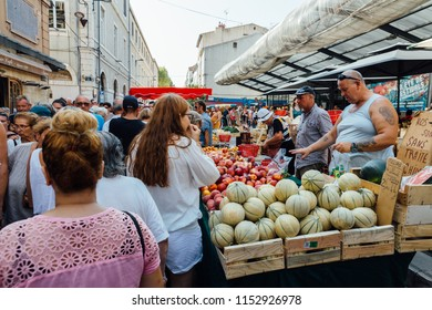 Sete, France - August 8, 2018: A crowded street market in the old town of Sete, France.