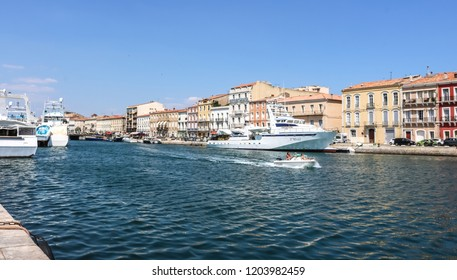 SETE, FRANCE - JULY 23, 2018: Boats on a canal in the city of Sete. France.
