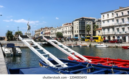 SETE, FRANCE - JULY 23, 2018: Colorful traditional boats in Sete, a seaside resort and singular island in the Mediterranean sea, it is named the Venice of Languedoc Roussillon, France.