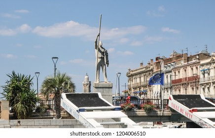 SETE, FRANCE - JULY 23, 2018: Monument to the participant of traditional water competitions on poles of Zhuts in Sete. France.