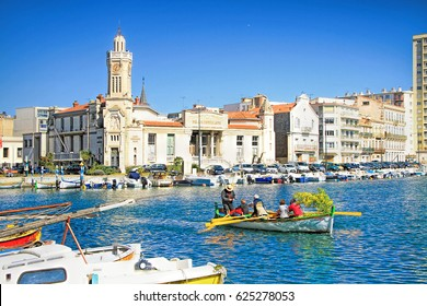 SETE, FRANCE - MARCH 03, 2015: colorful boat with mimosa flowers at the center of Sete - fascinating small town on the French Mediterranean coast  known as the Venice of Languedoc, south of France