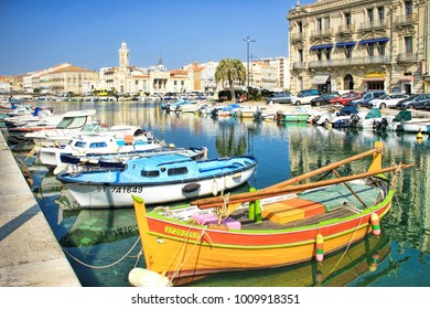 SETE, FRANCE - March, 12, 2015: Fisherman boats and The Consular Palace at the Royal Channel in Sete, south of France