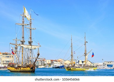 """SETE, FRANCE - March 24, 2016:  Russian frigate Shtandart in imaginary battle with Czech frigate La Grace during the """"Stopover in Sete"""" - Maritime Traditions Festival in Sete, South of France"""