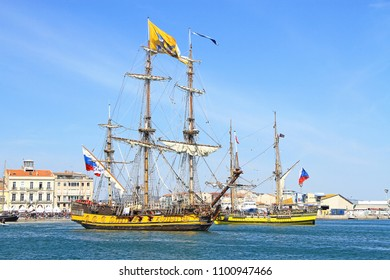 """SETE, FRANCE - March 24, 2016:  Russian frigate Shtandart in imaginary battle with Czech frigate La Grace during the """"Stopover in Sete"""" - Maritime Traditions Festival from the 22 to 28 march 2016"""