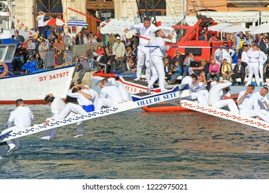 SETE, FRANCE - March 26, 2016: Water Jousting performance during Stopover in Sète – Maritime Traditions Festival from the 22 to 28 march 2016  at the streets of Sete, South of France