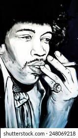 SETE, FRANCE  - SEPTEMBER 21, 2014: Graffiti portrait of Jimi Hendrix - one of the most celebrated musicians of the 20th century, on the wall of Sete, south of France.