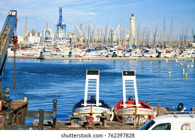 SETE, FRANCE - September 21, 2014: Lighthouse of the Saint-Louis mole and juister boats in Sete, Languedoc-Roussillon   In Sete, South of France