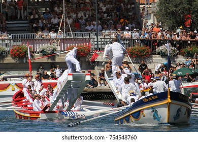 Sete, Herault, France  - Aug 21 2017: Traditional French Water Jousters competing at the 2017 Festival of Saint-Louis in Sete, Herault, Languedoc, France