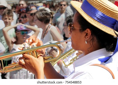 "Sete, Herault, France  - Aug 21 2017: Brass player in the traditional French band ""Los Marineros"" marching at the 2017 Festival of Saint-Louis in Sete, Herault, Languedoc, France"