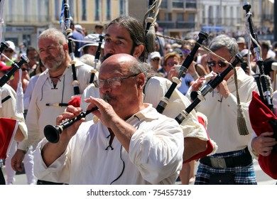 "Sete, Herault, France  - Aug 21 2017: Kilted bagpipers of the traditional French Celtic band ""Bagad Aix en Provence"" marching at the 2017 Festival of Saint-Louis in Sete, Herault, Languedoc, France"