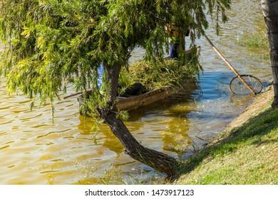 Sete Lagoas/Minas Gerais/Brazil - JUL 10 2015: Pond cleaning in the center of Sete Lagoas