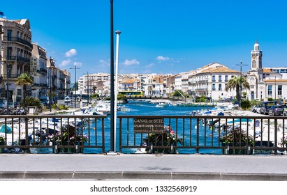Sete, Languedoc Roussillon - 21 06 2018: Quiet and peaceful view of typical fisher boats and colorful houses from the bridge