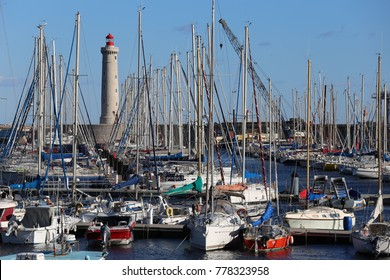 Sete port in France, with the red lighthouse and many colored boats. The picture has been taken in sete city, in France, on 26th of november 2017.