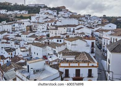 Setenil de las Bodegas is a town in the province of Cádiz, Spain, famous for its dwellings built into rock overhangs above the Rio Trejo.