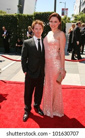 Seth Green and Clare Grant at the 2010 Primetime Creative Arts Emmy Awards,  Nokia Theater L.A. Live, Los Angeles, CA. 08-21-10