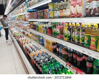 Setia Alam , Malaysia - 13 April 2018 : Line or row a assorted juice and carbonated drinks in the supermarket shelves.