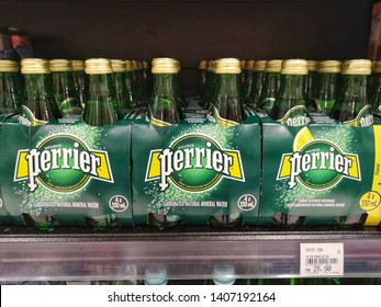 Setia Alam, Malaysia - 6 April 2019 : Assorted a bottle's of PERRIER Lemon drink display for sale in the supermarket shelves with selective focus.