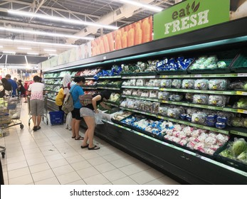 Setia Alam Selangor, Malaysia - March 10, 2019 : buyer in the vegetable section at Tesco supermarket, various selection of vegetable  on shelf for customer selection at Tesco Supermarket